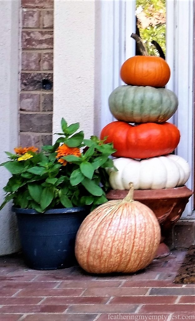 Stack of colorful pumpkins --On Board With The Gourd-How To Preserve And Display Pumpkins-