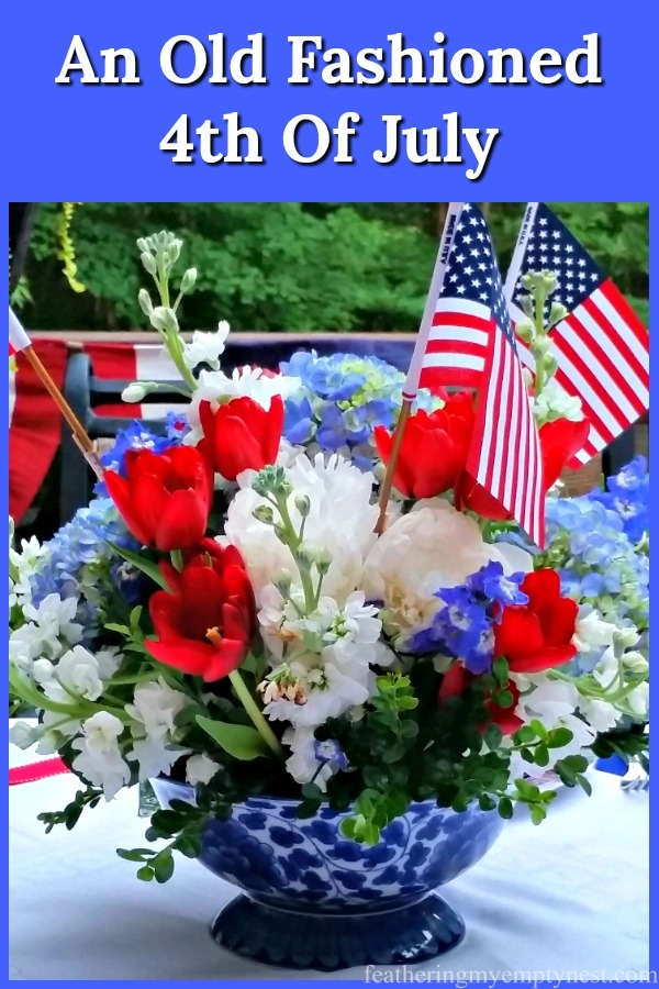 An old-fashioned 4th of July tablescape outside on the deck and inspired by red, white and blue bunting, featuring a colorful eclectic table setting, #4th Of July, Red, White & Blue Tablescape, #4th Of July Ideas, Patriotic table