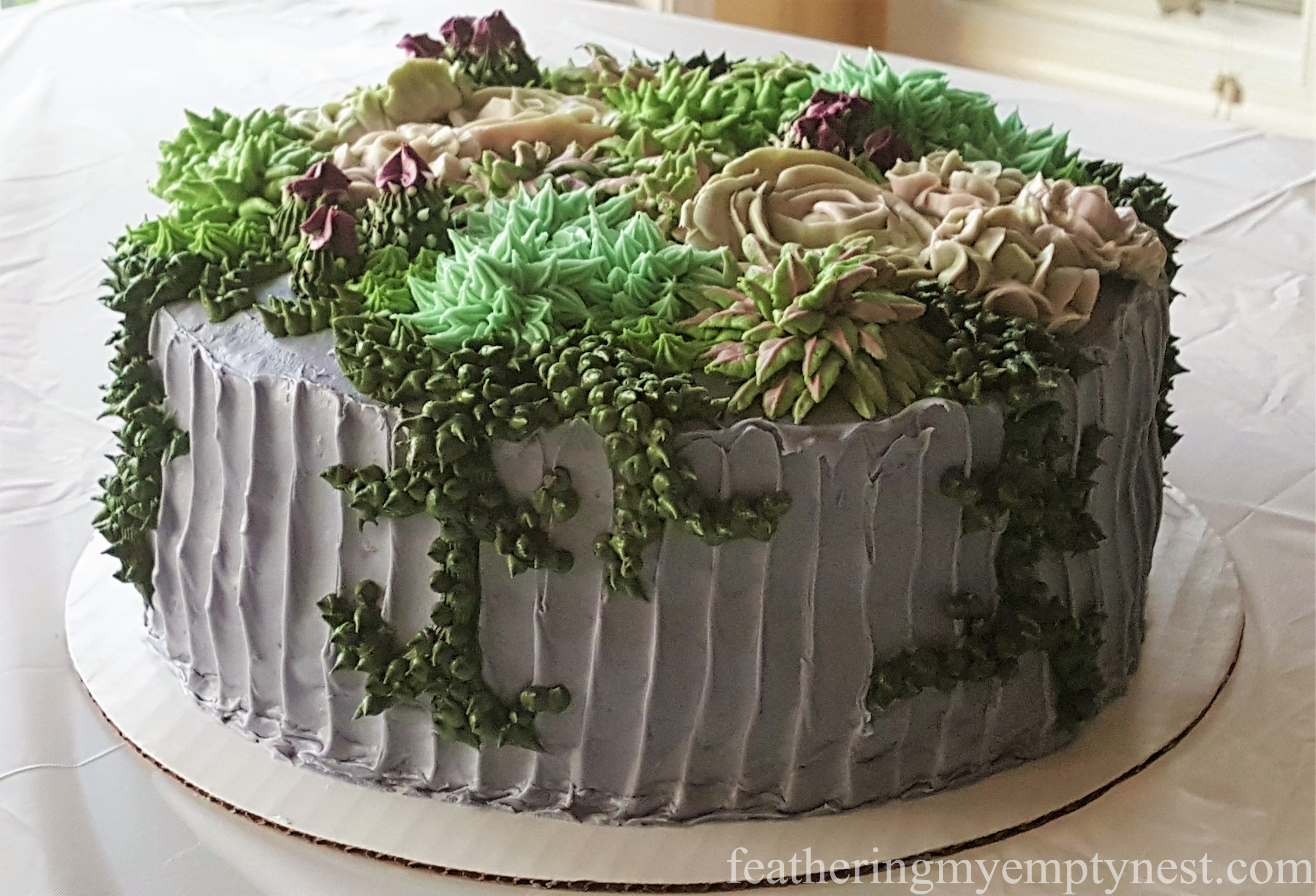 Succulent cake with textured base created for a Trendy Succulent-Themed 80th Birthday Party