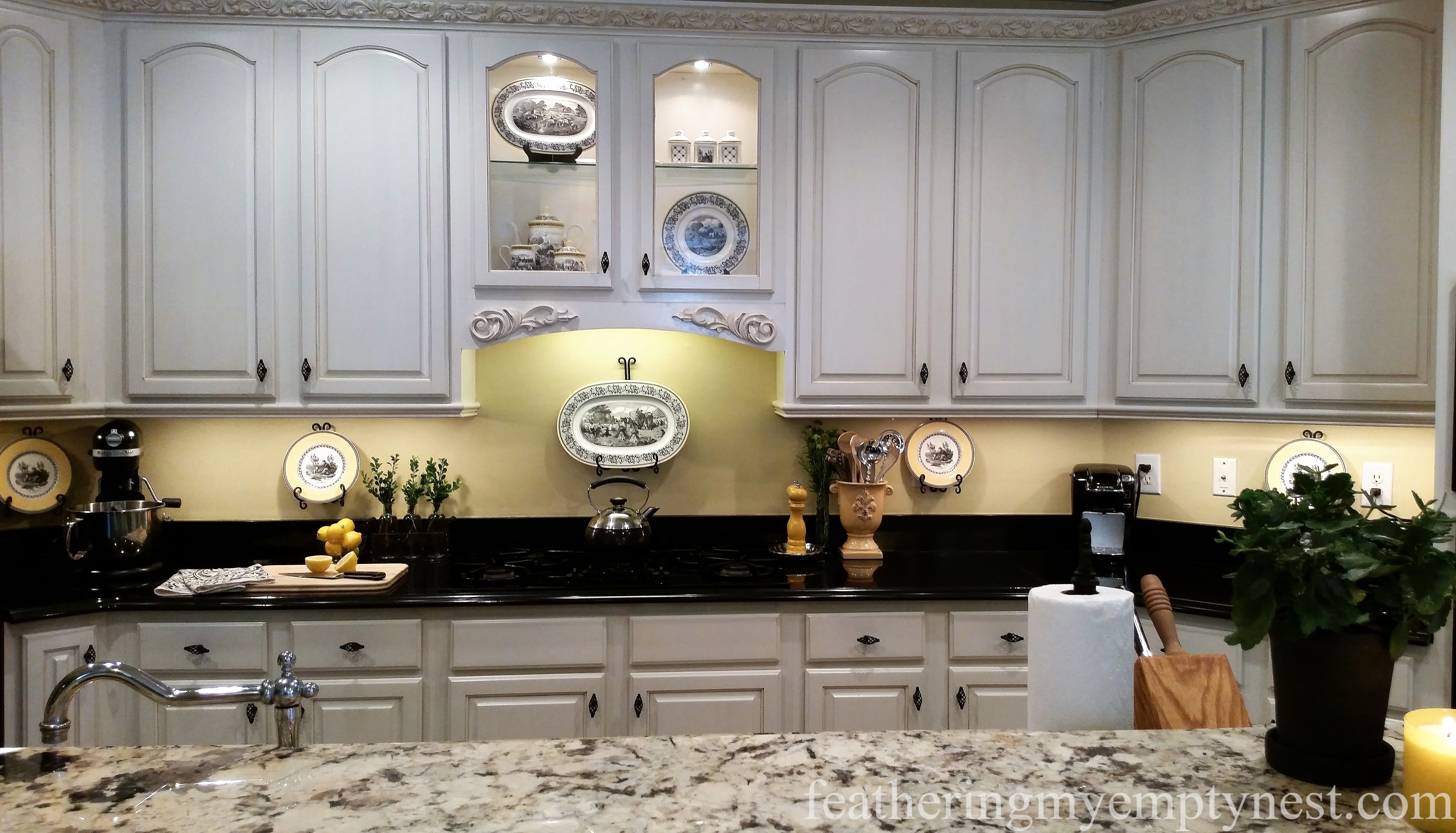 Painted and glazed kitchen cabinets with black birdcage knobs-Inexpensive Kitchen Updates And Camouflage