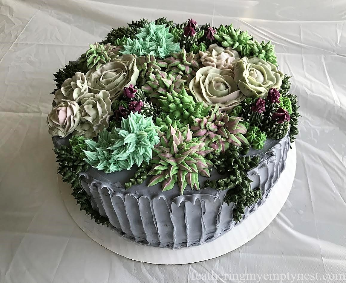 A succulent succulents cake for an 80th birthday party feathering buttercream succulent topped birthday cake for trendy succulent themed 80th birthday party izmirmasajfo