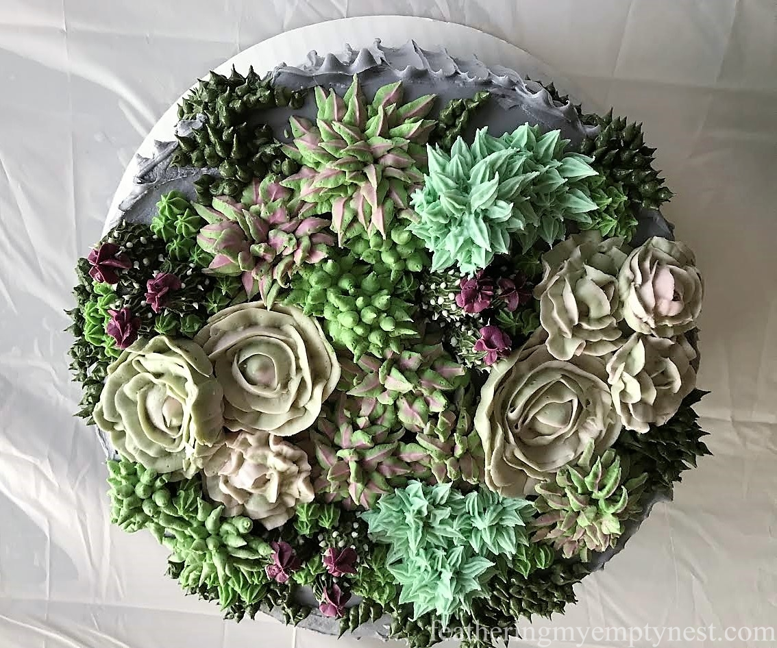 A succulent succulents cake for an 80th birthday party feathering a variety of colorful buttercream succulents adorn a cake for a trendy succulent themed 80th izmirmasajfo