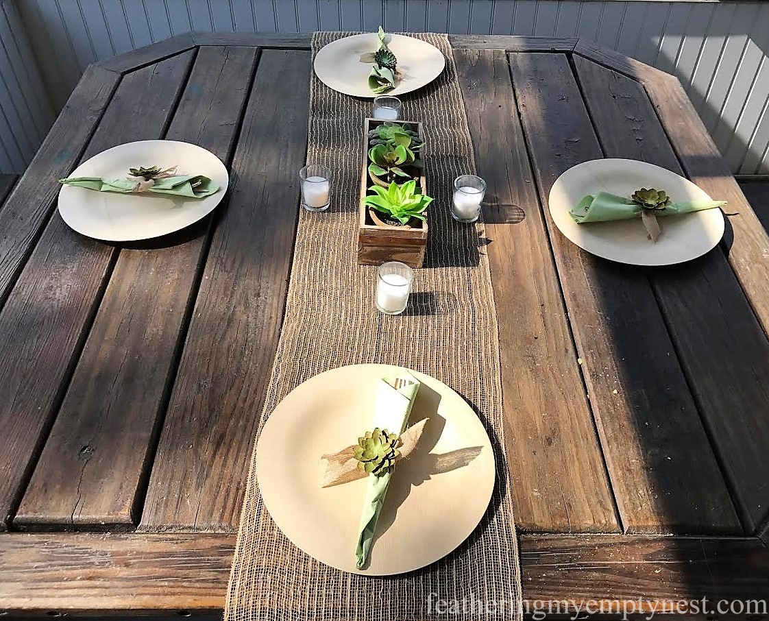 Disposable bamboo plates and cutlery add another natural element to the Trendy Succulent-Themed 80th Birthday Party.