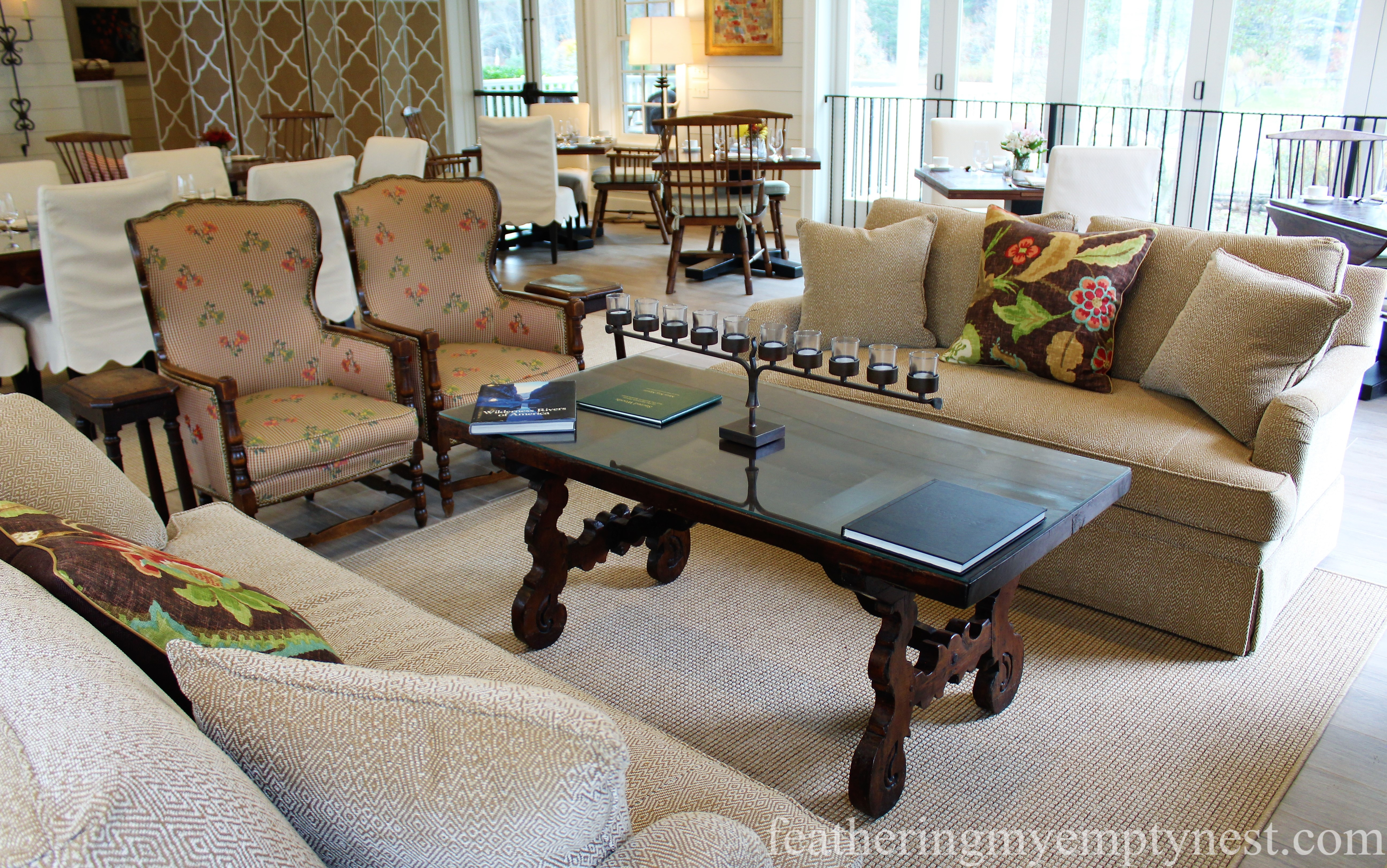 vibrant floral fabric enliven a sitting area at the Inn At Half Mile Farm --Elegant Colorful Farmhouse Style