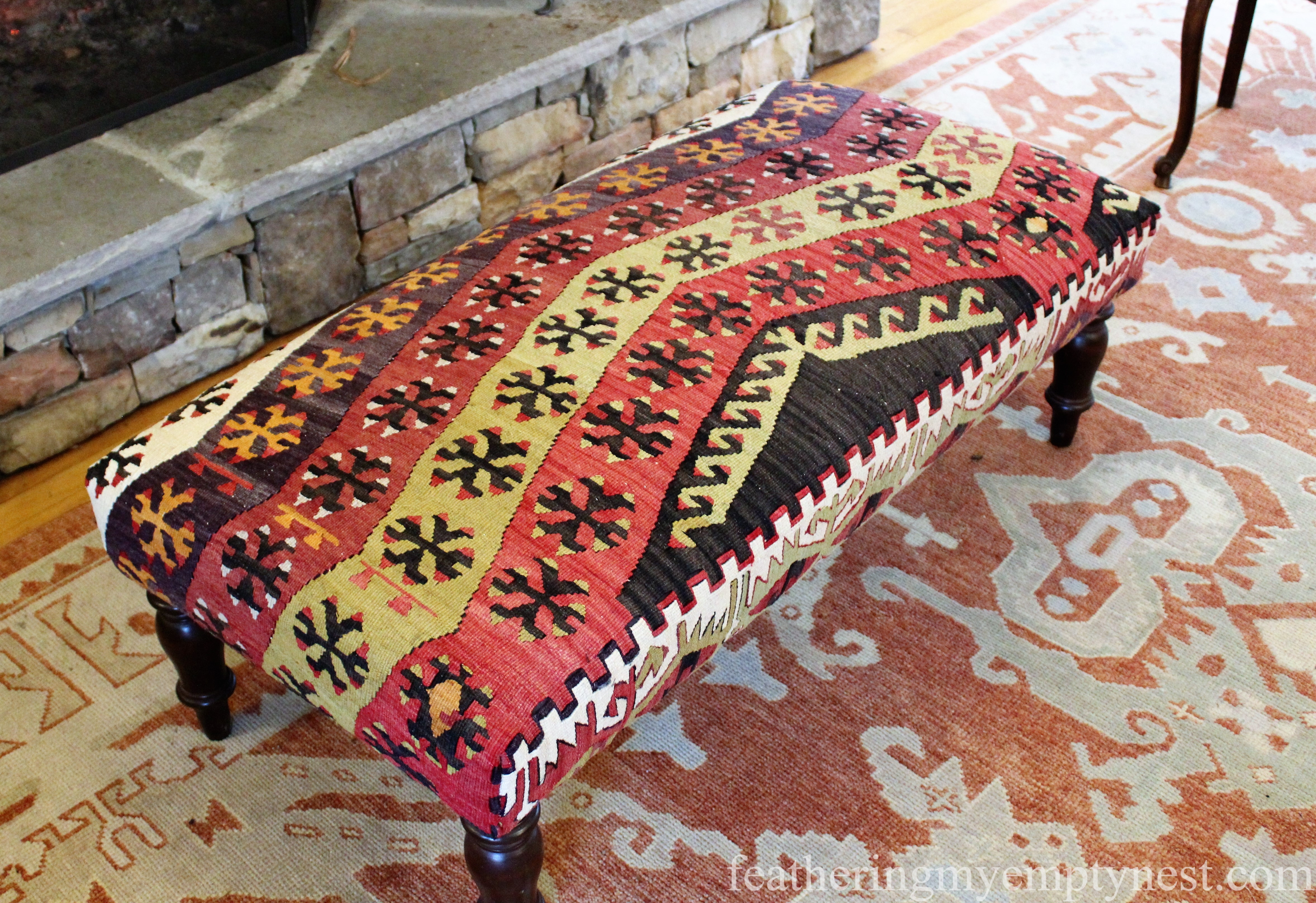 Kilim covered bench adds additional color and pattern to the sitting room at Half Mile Farm Inn --Elegant Colorful Farmhouse Style