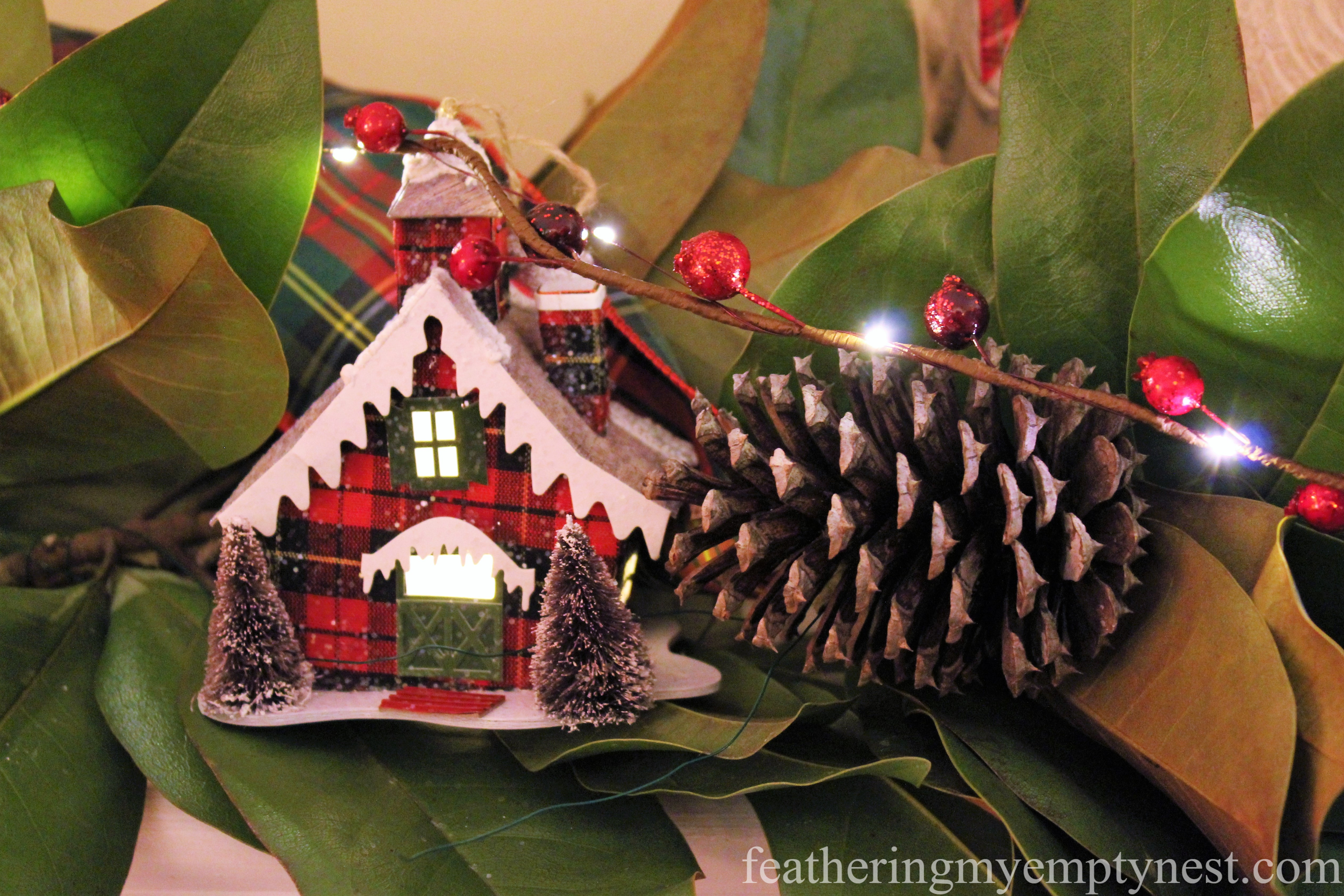 Plaid house ornaments from Pier One adorn a fresh magnolia garland --Mad For Plaid Christmas Mantel