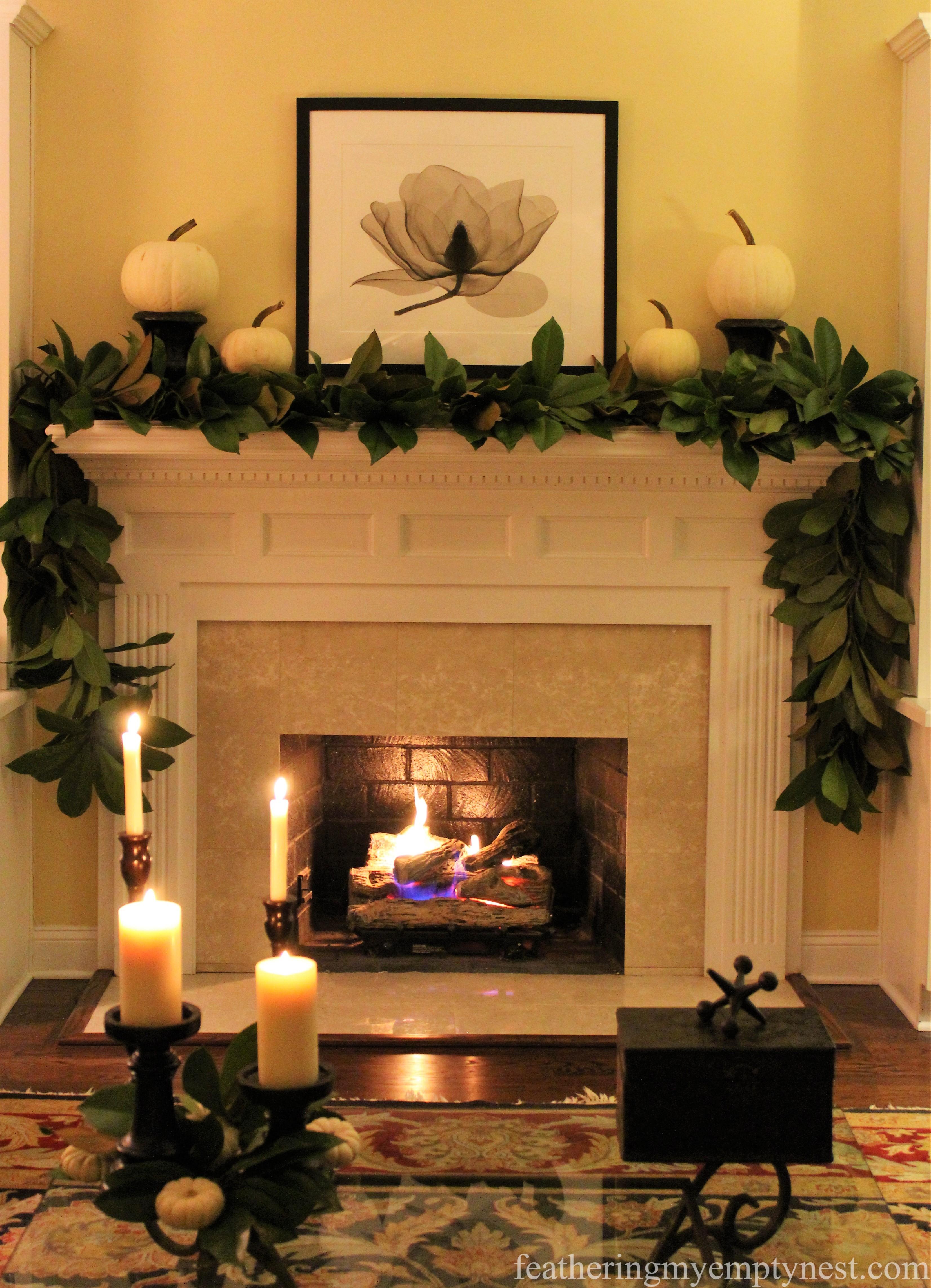 DIY Thanksgiving fresh magnolia garland was re-purposed for Christmas by adding plaid ribbon and ornaments --Mad For Plaid Christmas Mantel