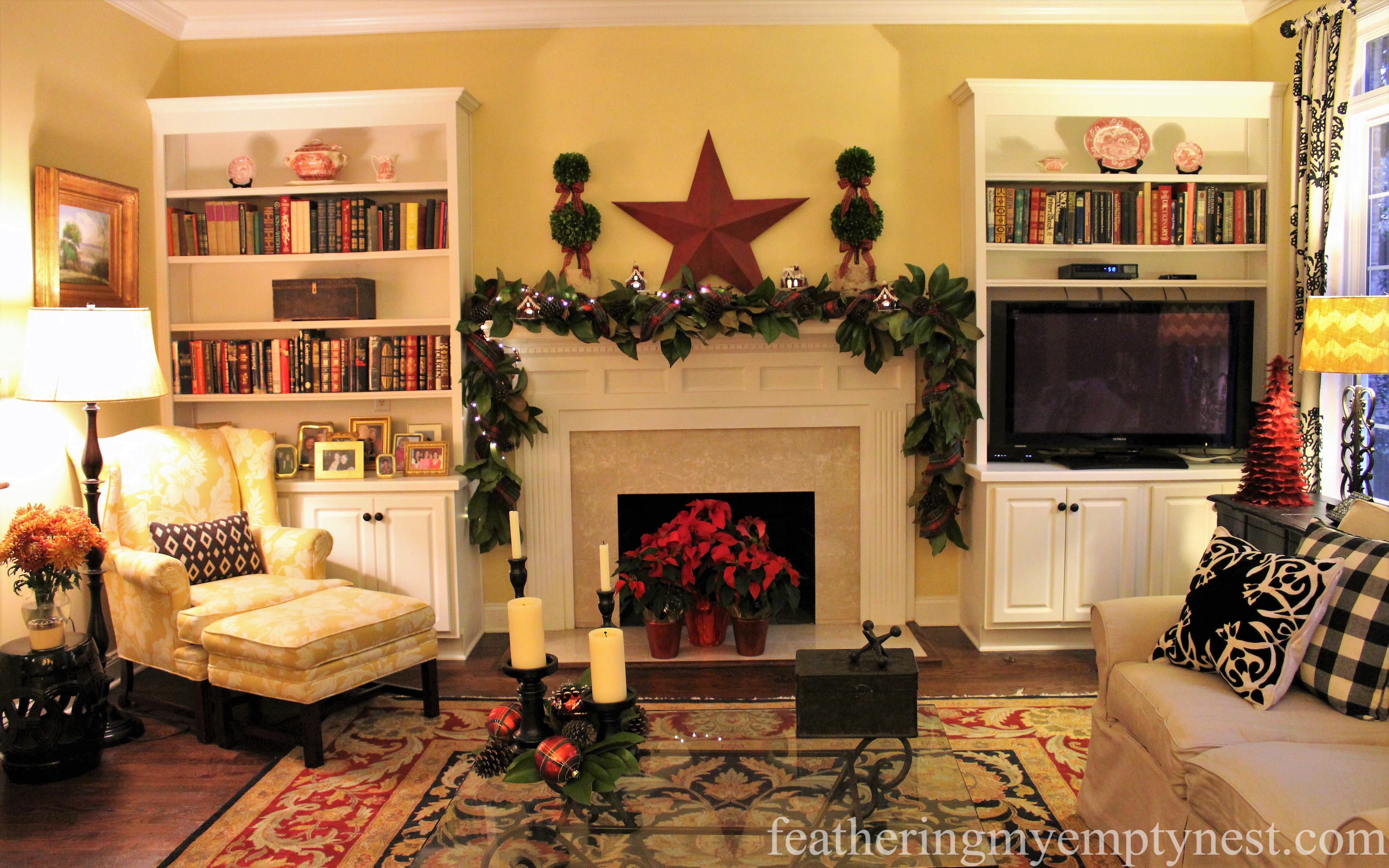 Family room dressed for Christmas with lots of red accents and plaid ribbons --Mad For Plaid Christmas Mantel