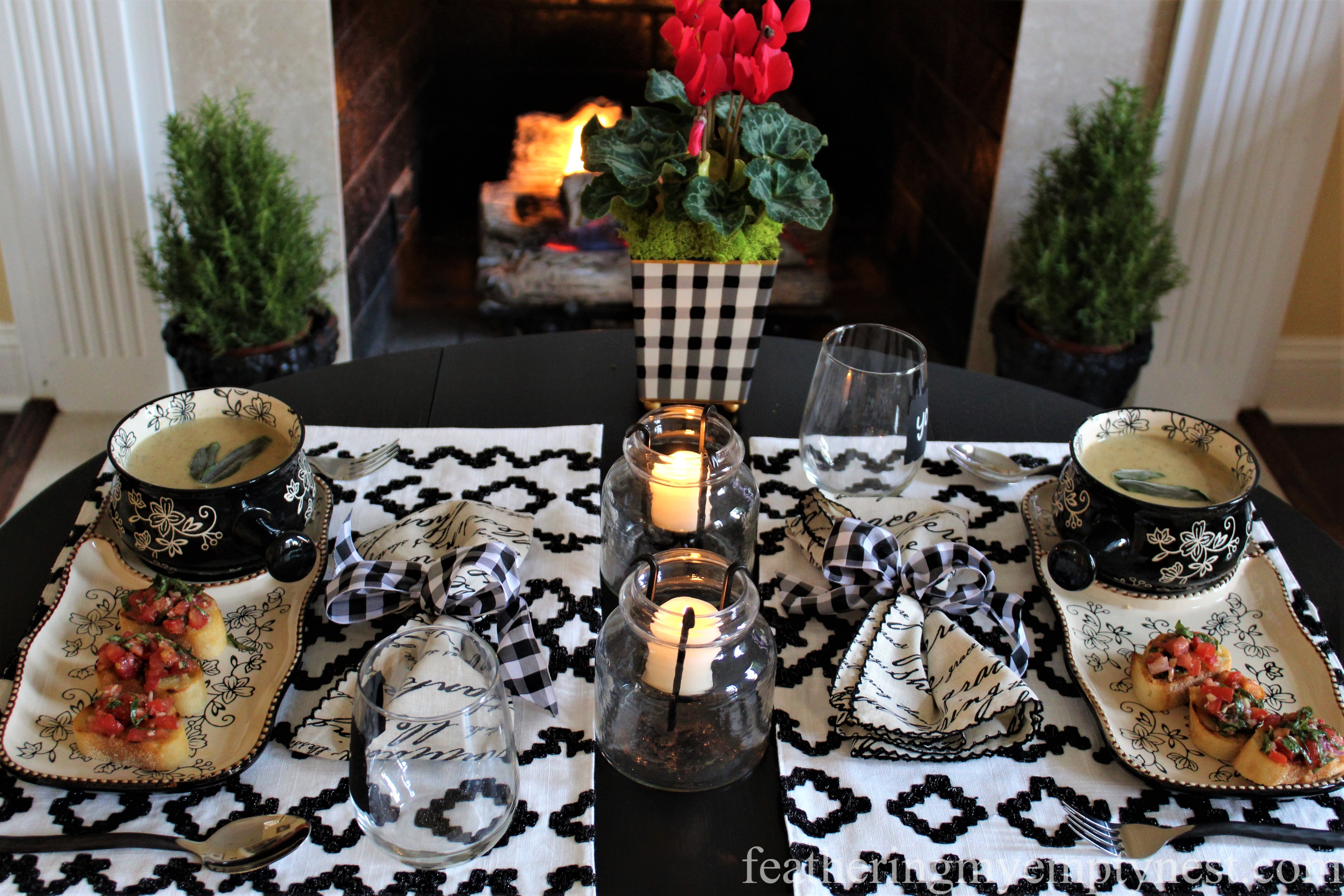 Beautifully set black and white fireside table is the perfect setting for a winter's meal of White Bean Soup and Bruschetta