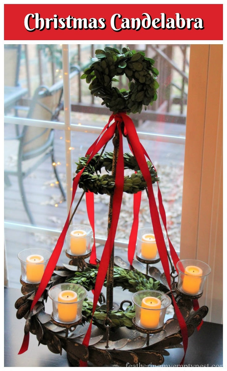 Give a plain candelabra some holiday cheer by adding 3 different sized preserved boxwood wreaths and some red ribbon --Pancakes & Plaid: A Christmas Breakfast Table