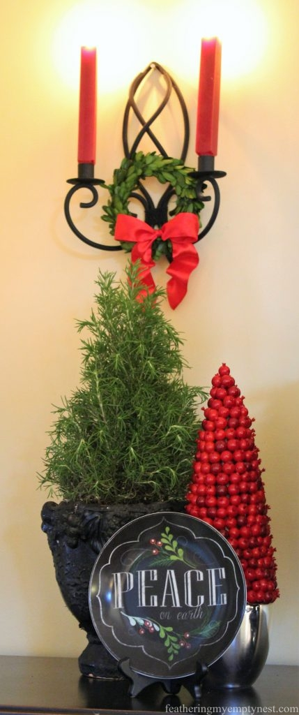 Live Rosemary tree, faux cranberry tree, chalkboard plate and candle sconce --Pancakes & Plaid: A Christmas Breakfast Table