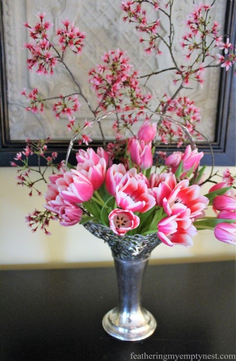 Tulips and crabapple blossoms arranged in a silver basket vase --How To Polish Silver Naturally Without Hours Of Elbow Grease