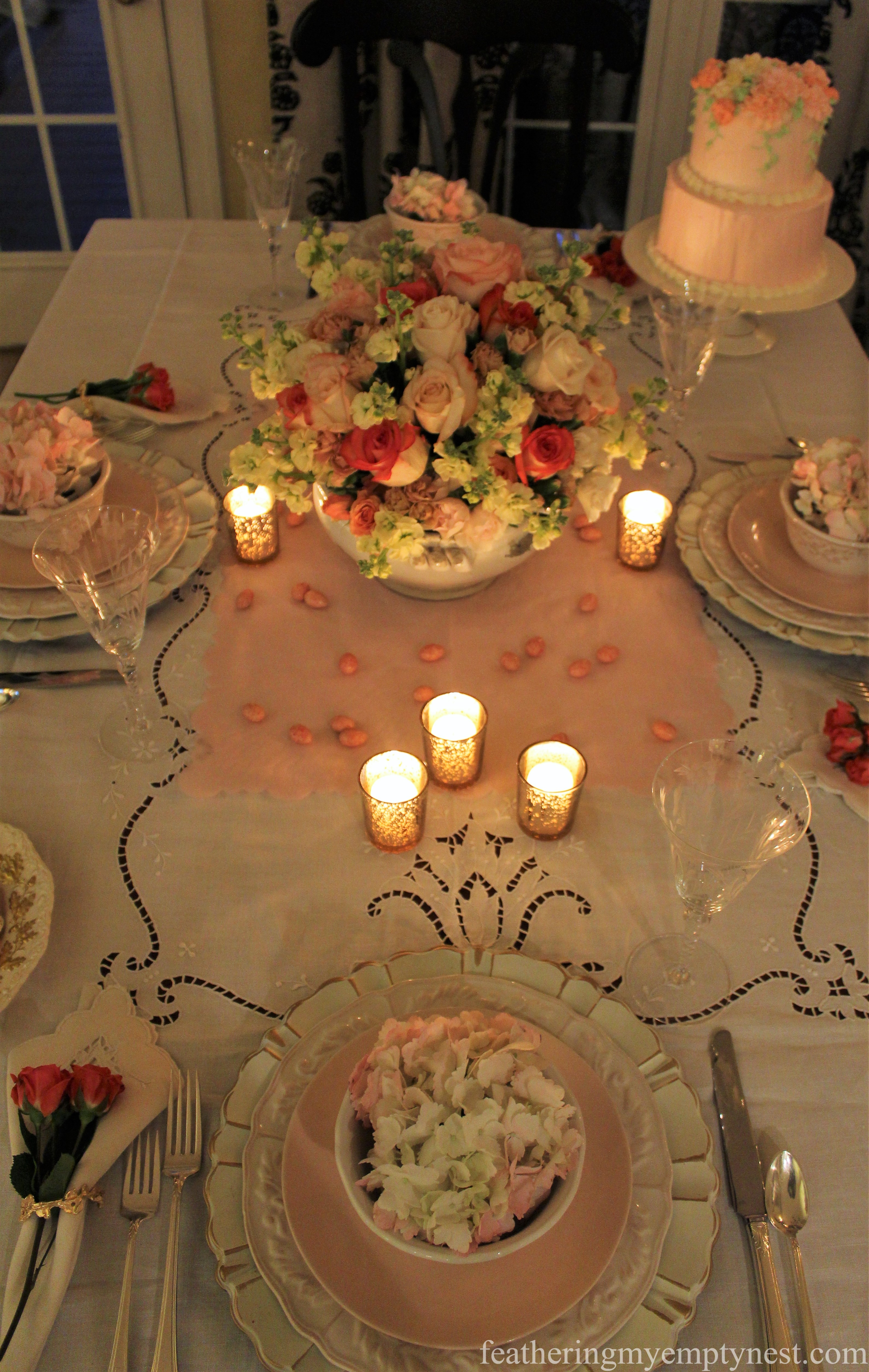 Candlelit view of Valentine's tablescape --How To Use The Language Of Flowers To Create A Blooming Valentine's Dinner