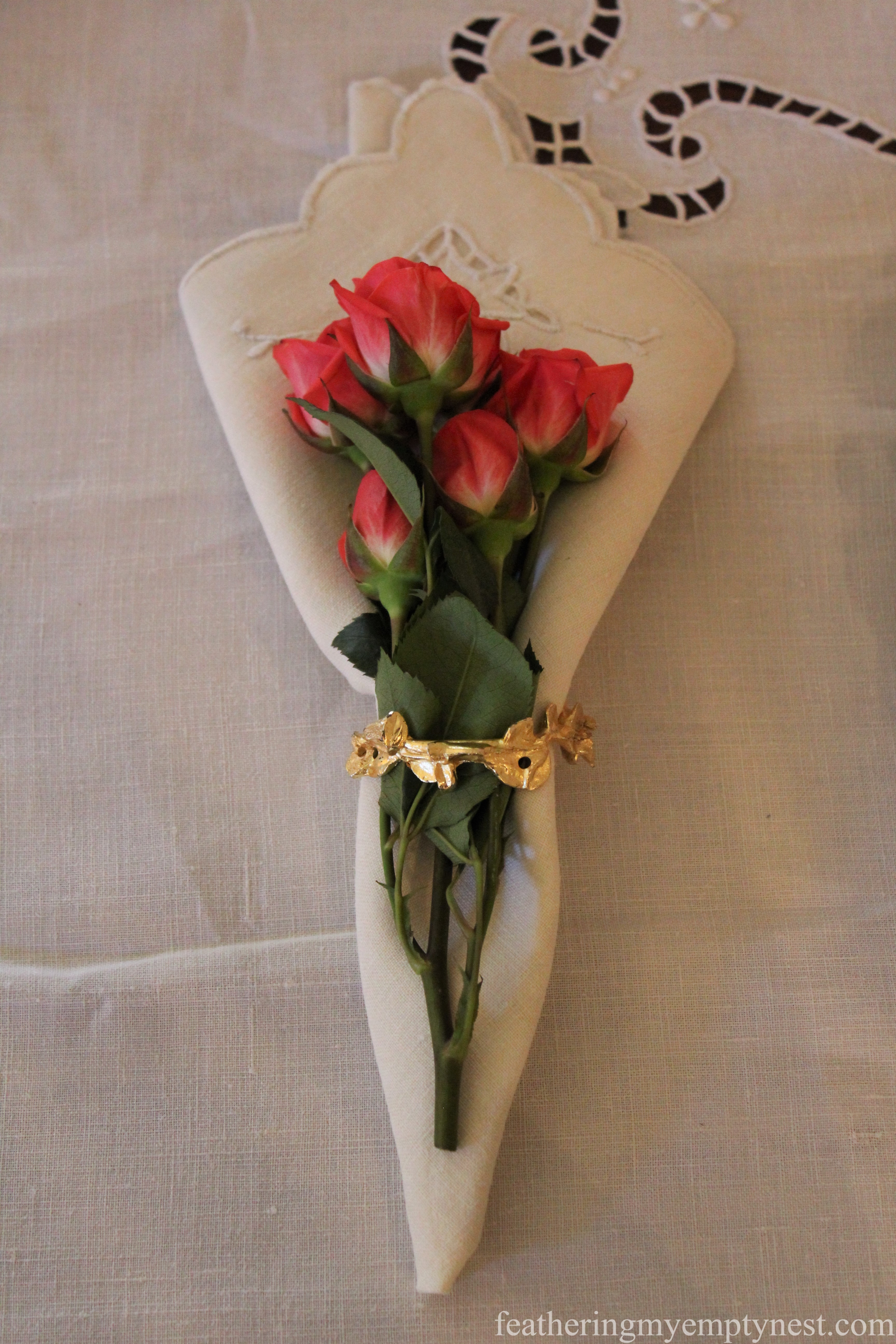 Napkin ring enhanced with coral spray roses --How To Use The Language Of Flowers To Create A Blooming Valentine's Dinner