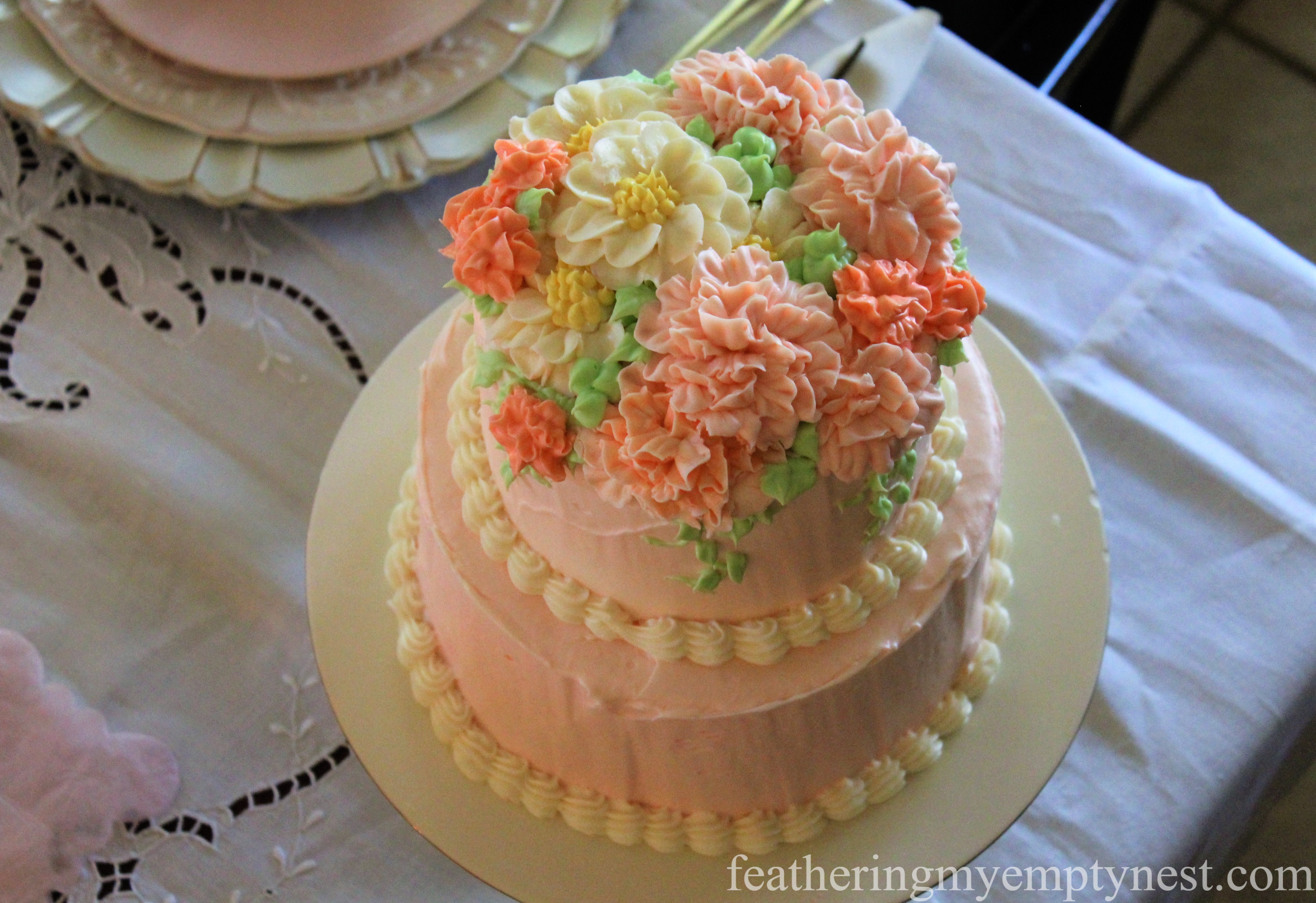 Buttercream flower decorated coconut cake --How To Use The Language Of Flowers To Create A Blooming Valentine's Dinner