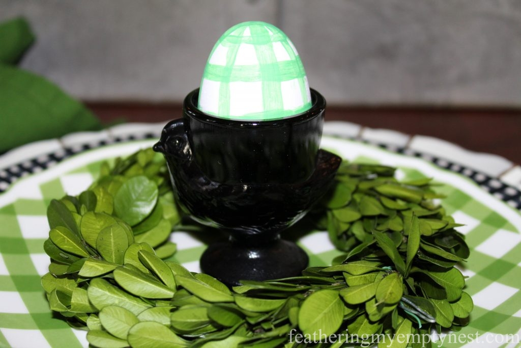Vintage Luninarc black glass hen egg cups hold green plaid Easter eggs --How To Set A Fresh Fun Farmhouse Easter Table