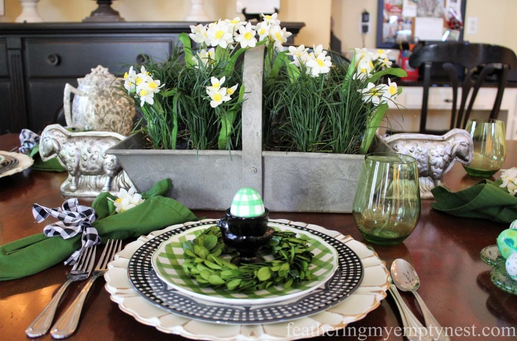 Galvanized basket is flanked by vintage-inspired silver lamb chocolate molds --How To Set A Fresh Fun Farmhouse Easter Table