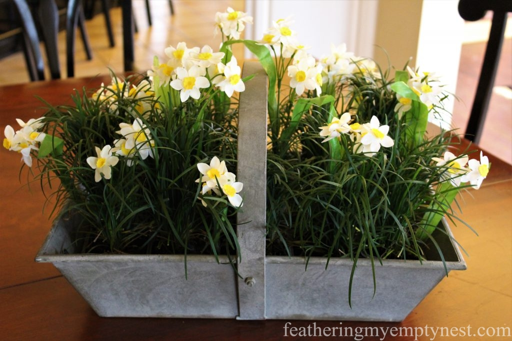 "Faux Narcissus ""grow as if naturalized in live Mondo Grass --Faux Narcissus are planted in live Mondo Grass for a convincing Spring display"