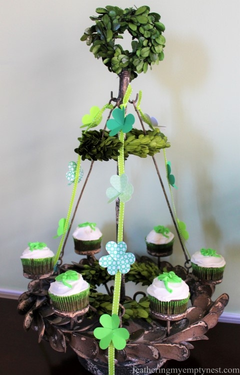 Colorful paper Shamrock-studded ribbons decorate a festive cupcake candelabra --St. Patrick's Day Irish Cream Shamrock Cupcakes