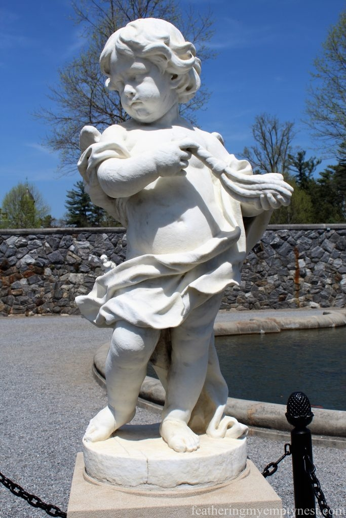 Statue of a cherub in the Italian Garden of the Biltmore Estate in Asheville, NC --A Spring Tour Of The Biltmore Estate Gardens