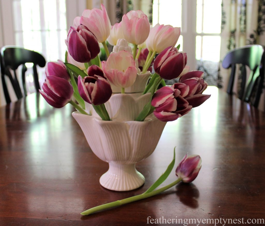 Beautiful Spring tulips are shown off to best advantage in a white artichoke-shaped tulipiere --Arranging Tulips With Flower Arranging Tools & Tulipieres