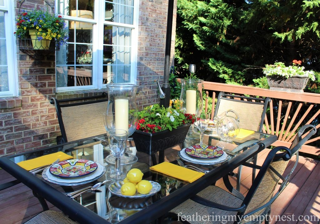 Al fresco dining with Summer Flower Planters On The Deck