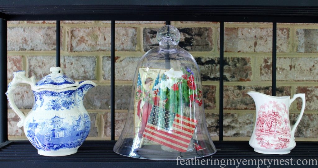 Antique red and blue transferware add to the vintage feel of the patriotic display on this baker's rack --Last Minute Memorial Day Decorations