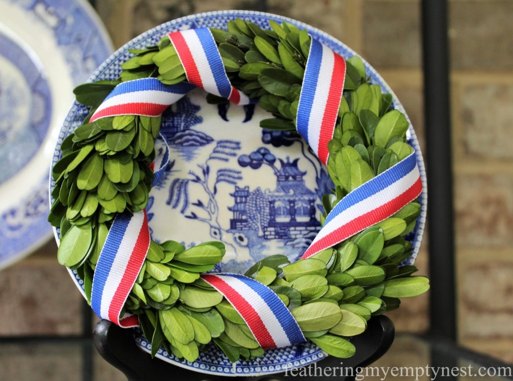 Blue Willow plate adorned with patriotic boxwood wreath --Last Minute Memorial Day Decorations