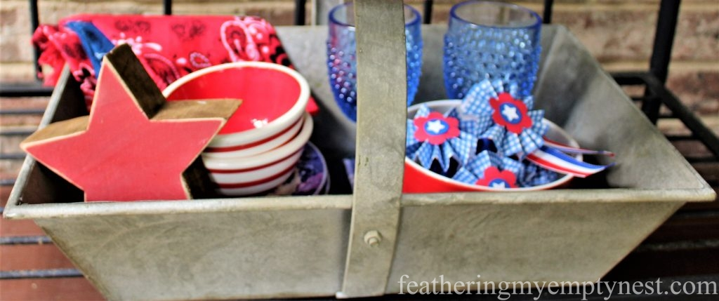 A basket full of red, white, and blue dishware is decorative as well as useful for a Memorial Day picnic.--Last Minute Memorial Day Decorations