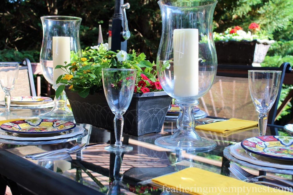 Outdoor dining with DIY umbrella planter --Summer Flower Planters On The Deck