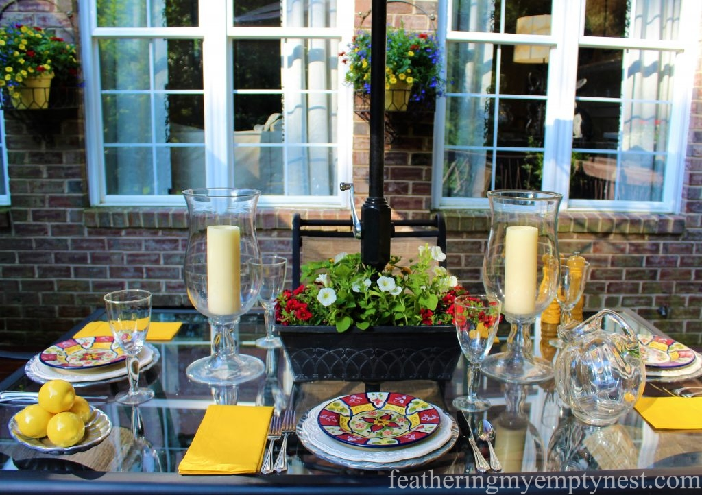 Outdoor table setting coordinates with the colorful summer planter on the deck ---Summer Flower Planters On The Deck