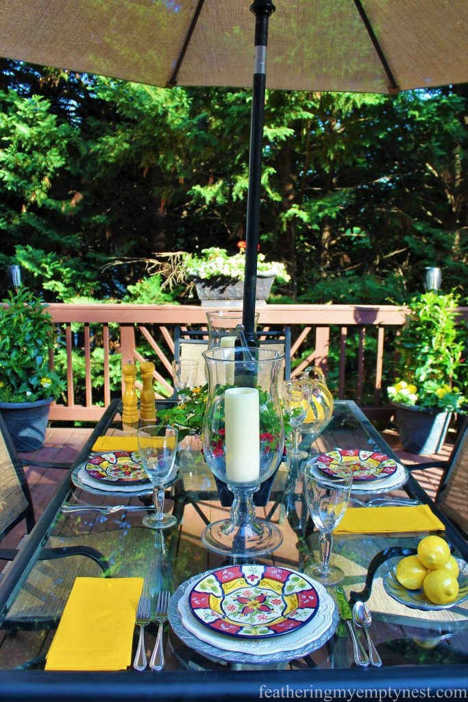 Colorful table set for al fresco dining ---Summer Flower Planters On The Deck