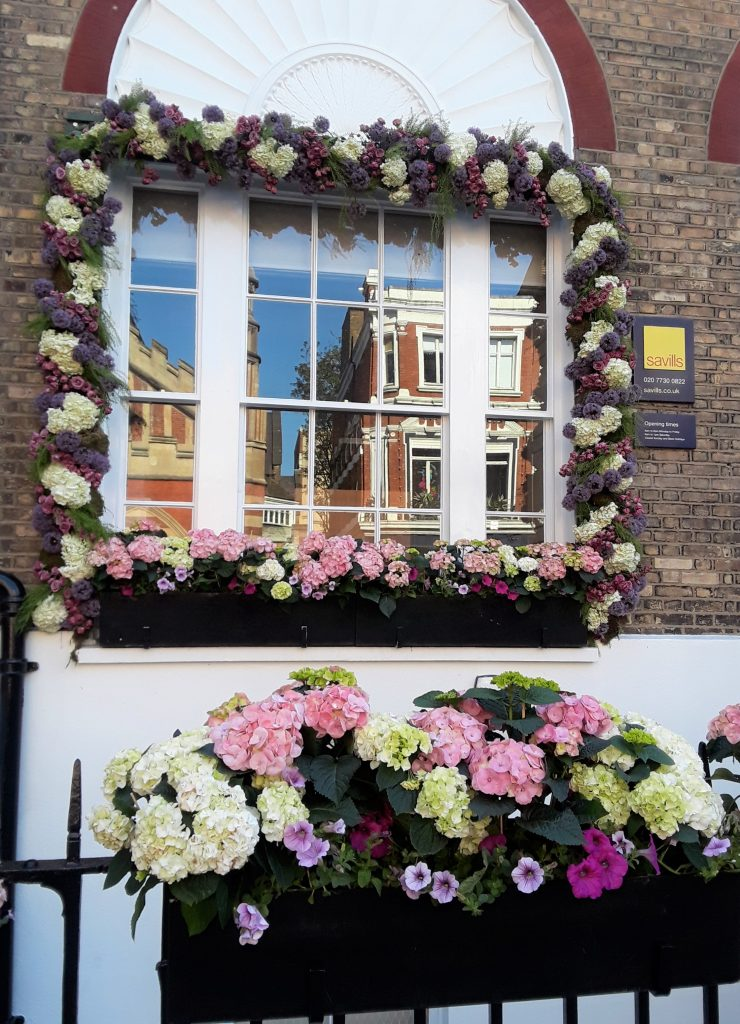 Garland and window boxes outside office space --Chelsea In Bloom: 2018 Chelsea Flower Show Part 1