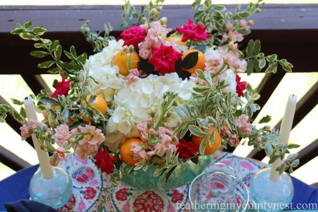 Flower arrangement with Mandarin Oranges for An Impromptu Outdoor Dining Table For Two