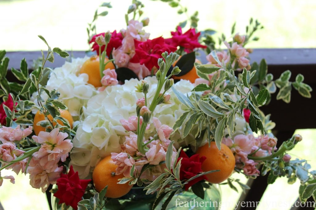 Colorful summer flowers and Mandarin Oranges for An Impromptu Outdoor Dining Table For Two