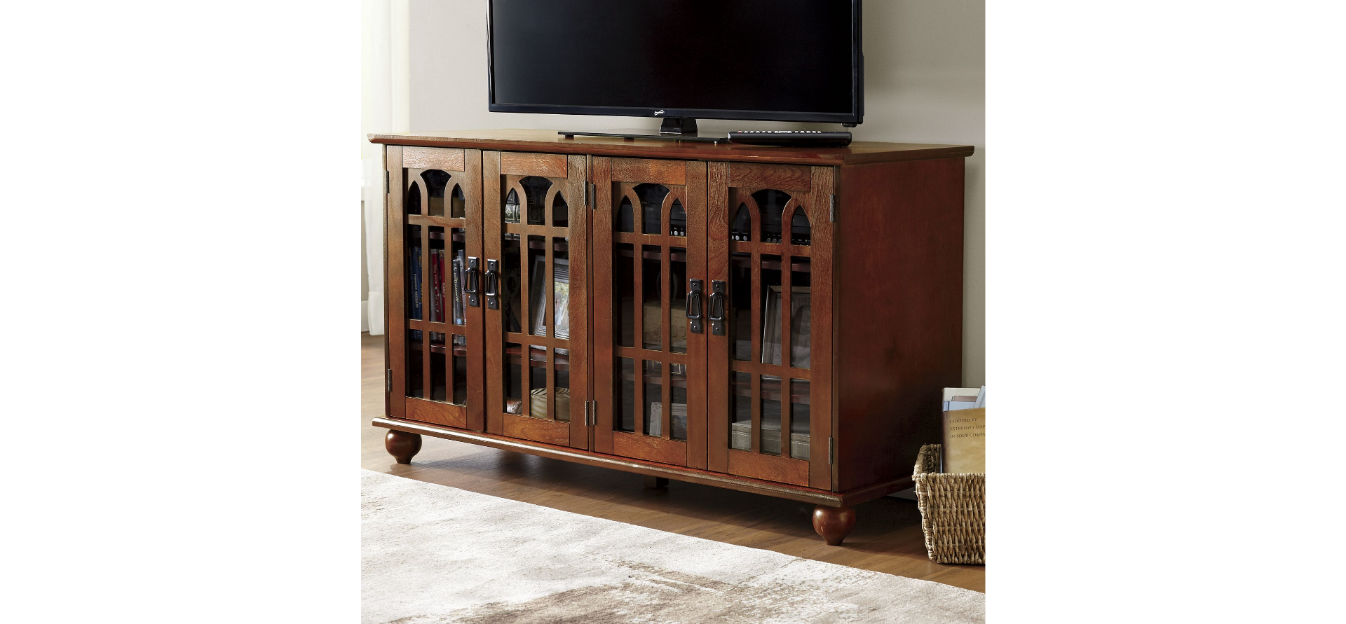 "The Mission style tv cabinet with its arched glass doors and wrought iron hardware looks expensive but was a bargain --""Inexpensive Apartment Decorating Ideas"""