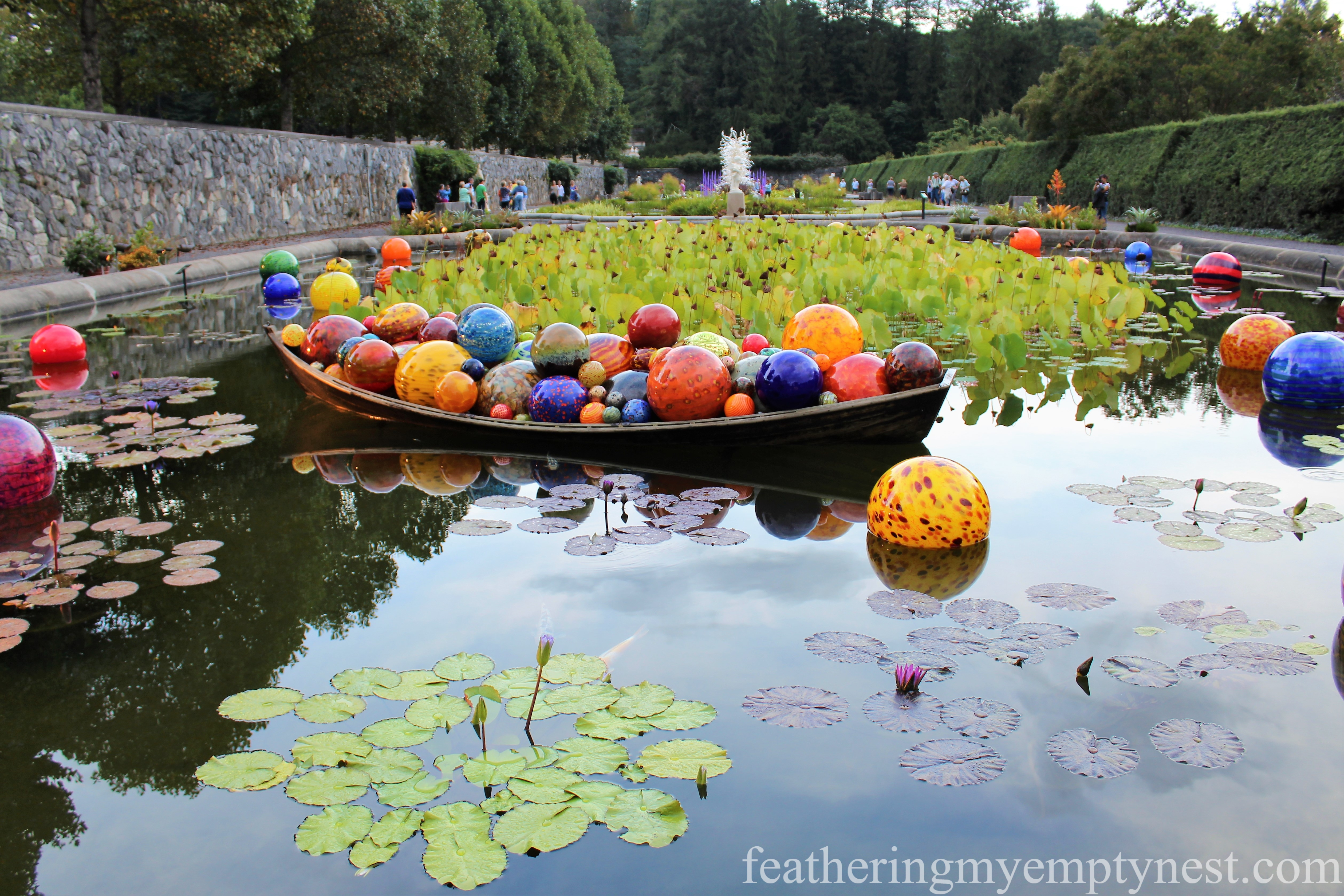 Chihuly glass sculpture installation in the Italian Garden at Biltmore --Chihuly At Night At The Biltmore