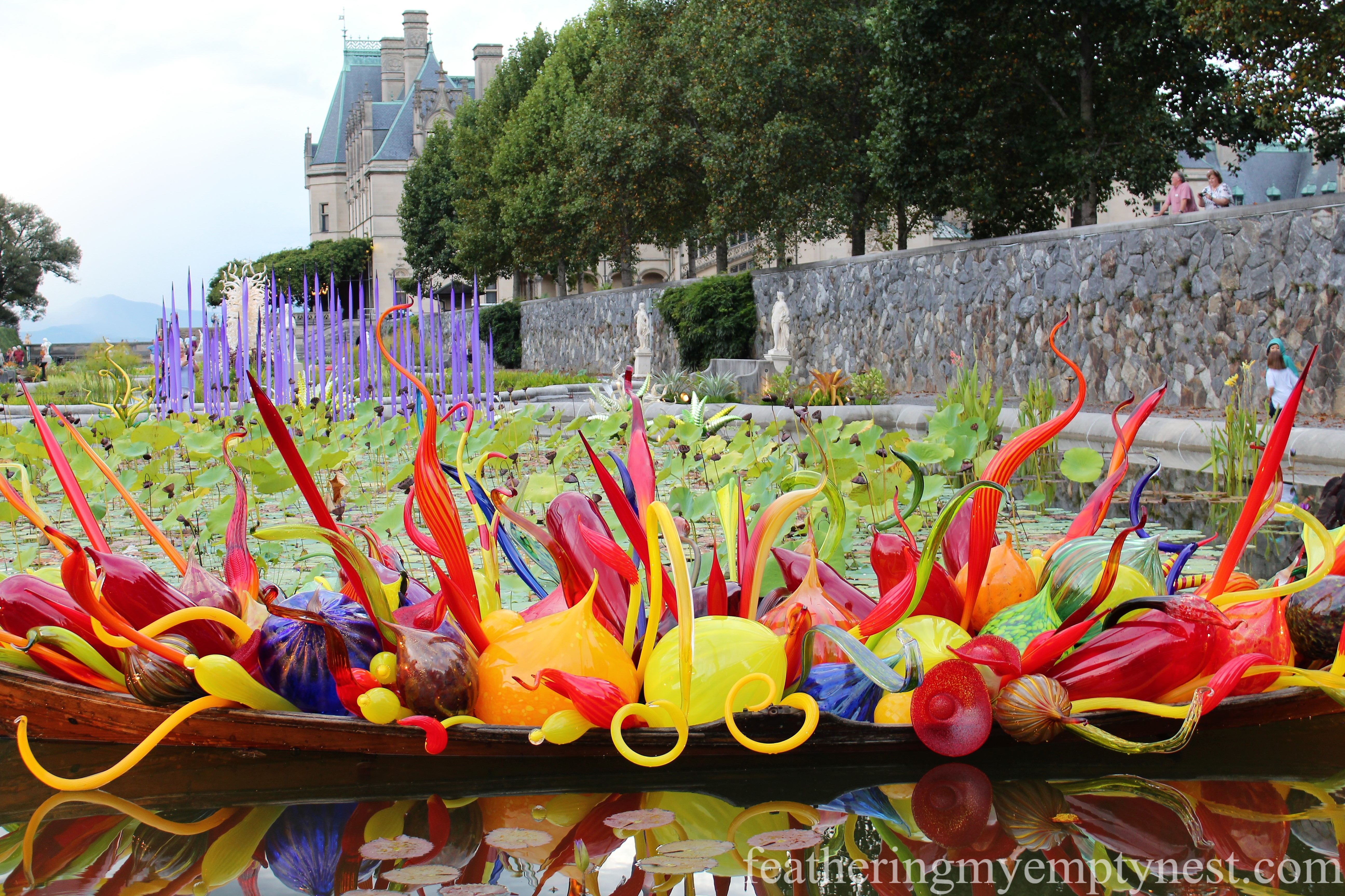 Chihuly glass sculpture Fiori Boat in the Italian Garden at Biltmore --Chihuly At Night At The Biltmore