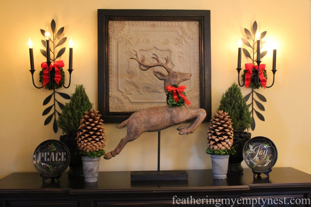 A symmetrical display of black and neutral items are dressed up for Christmas with the addition of natural green elements and red bows --Christmas Decorating Odds & Ends