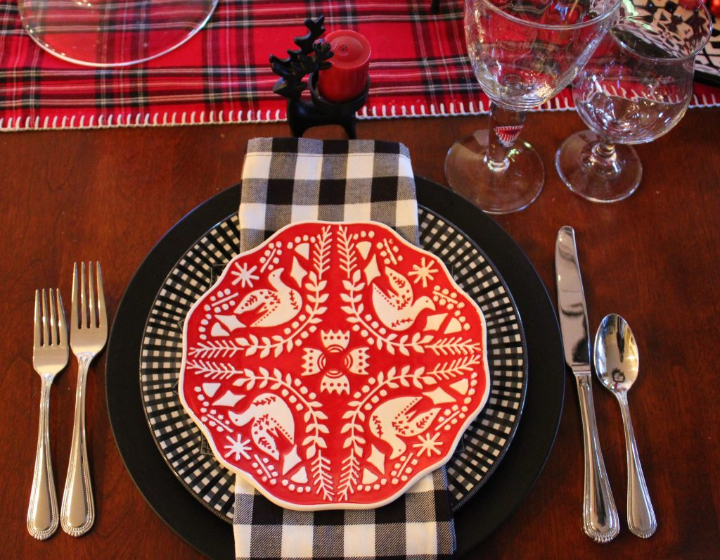 Place setting for a festive red and black Casual Christmas Table.