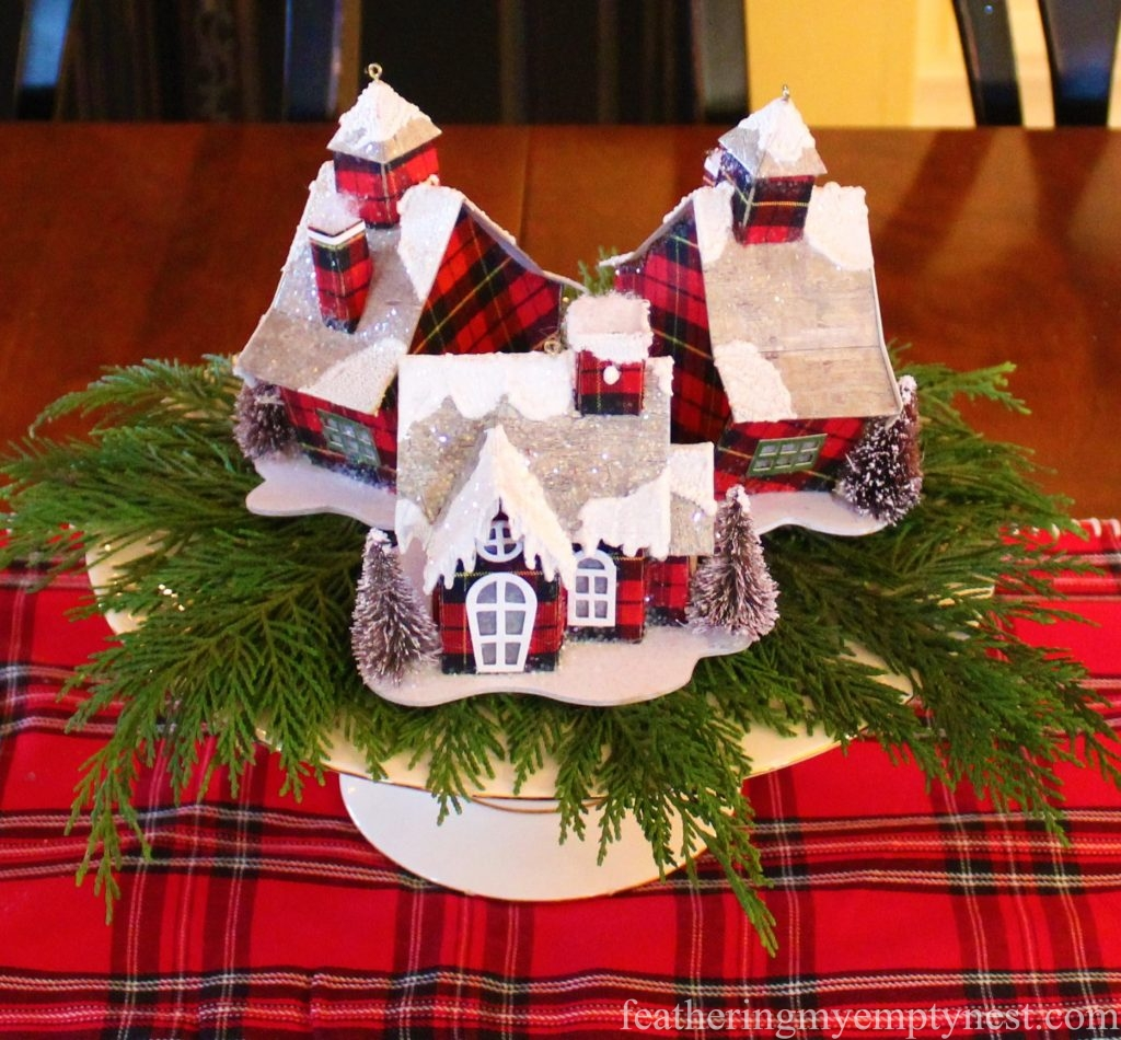 Plaid led ornaments are displayed on a greenery covered cake plate for a simple centerpiece --Christmas Decorating Odds & Ends