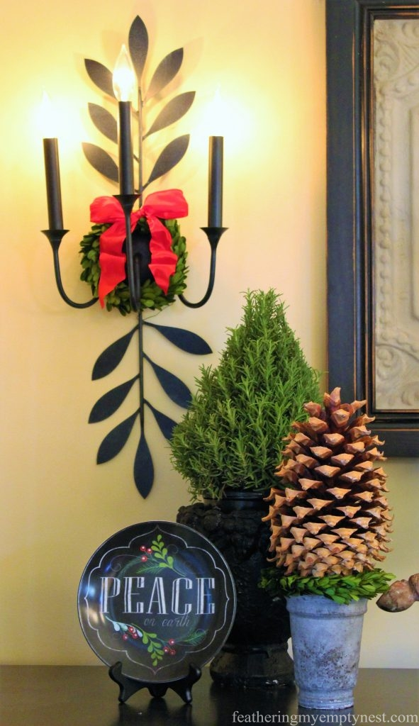 Rosemary and pine cone trees are grouped together with chalkboard plates on each end of a buffet  --Christmas Decorating Odds & Ends