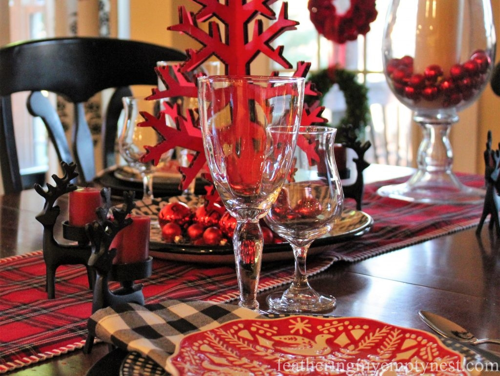 Red and black elements make this fun and festive casual Christmas table sparkle.