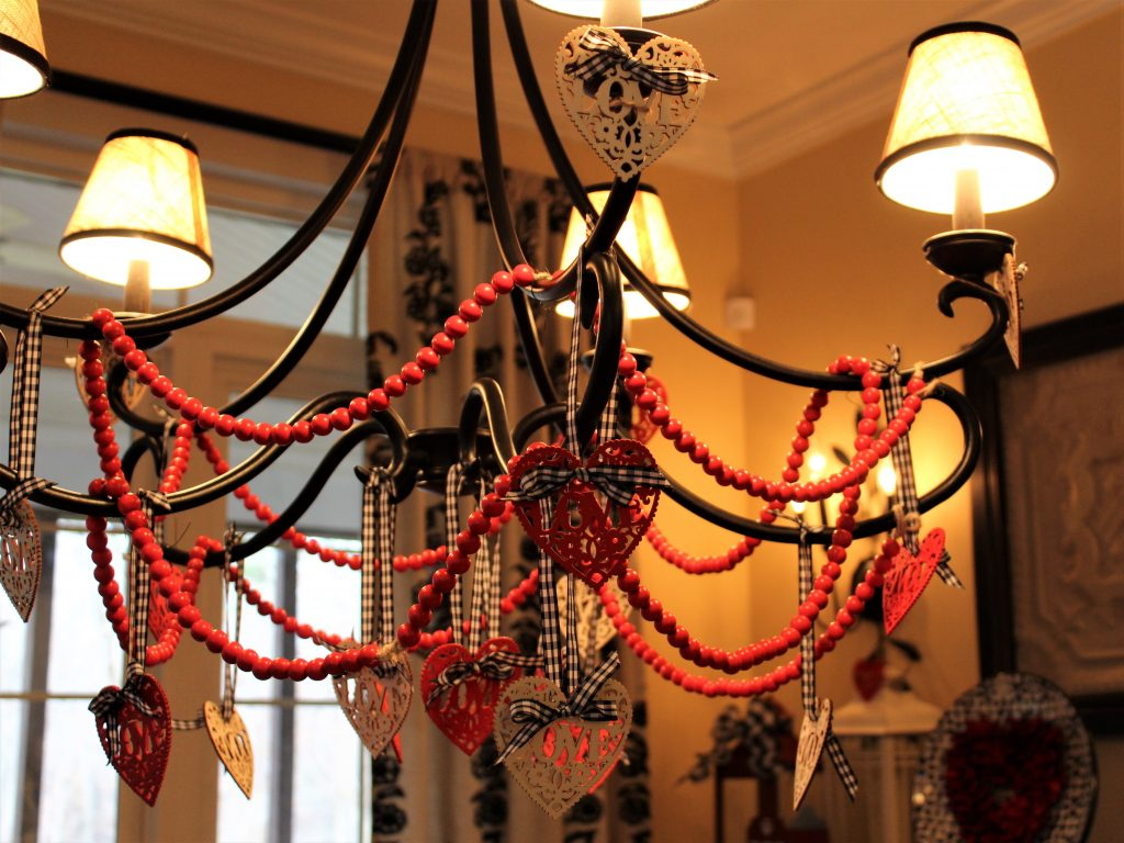 How to bring your Valentine's tablescape decor up to your chandelier using inexpensive craft store items.