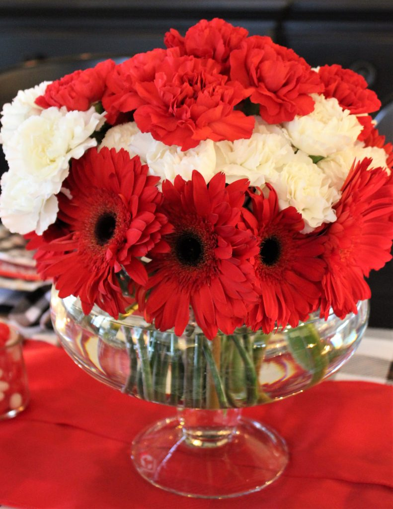 How to create a vibrant cheery Valentine's centerpiece using inexpensive grocery store flowers.