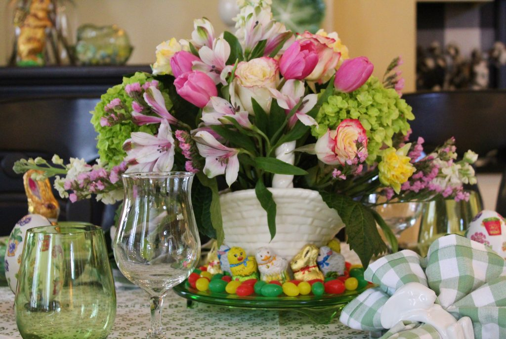 A Grown-up Easter Candy Tablescape--An Easter flower basket takes center stage on the table.