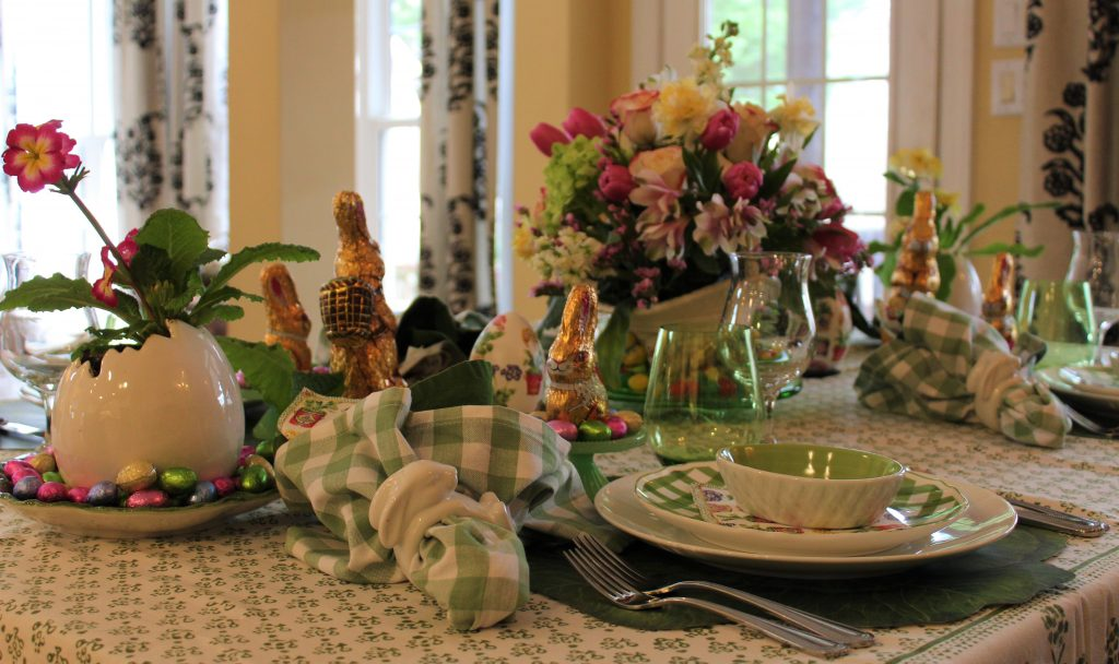 A Grown-up Easter Candy Tablescape--Colorful candy and flowers set against a backdrop of spring green linens make for a joyful Easter table.