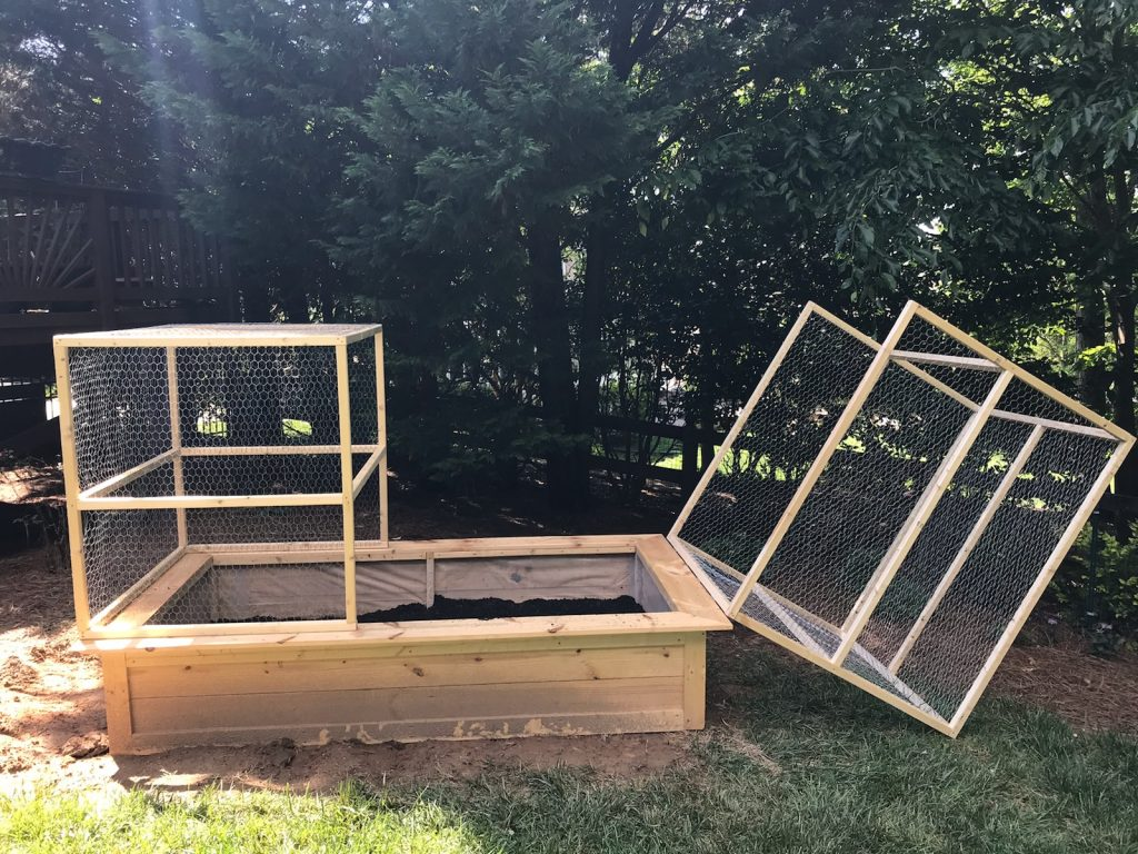 Lessons From A Novice Raised Bed Gardener-DIY raised bed garden with hinged deeproof cage.