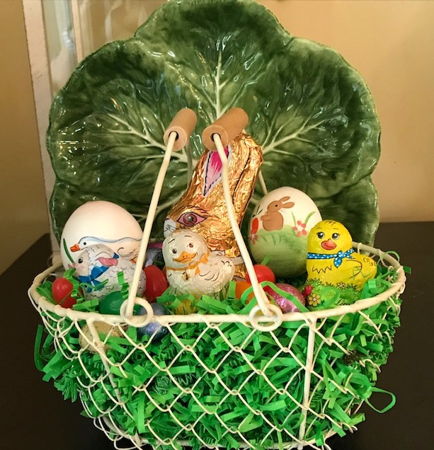 A Grown-up Easter Candy Tablescape--small Easter baskets filled with candy from the table make lovely gifts for guests.