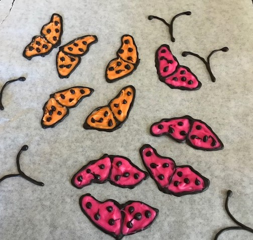 Piped chocolate butterflies for a cake- Butterfly Mother's Day Tablescape-